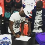 Peter Okoye signing the dotted lines