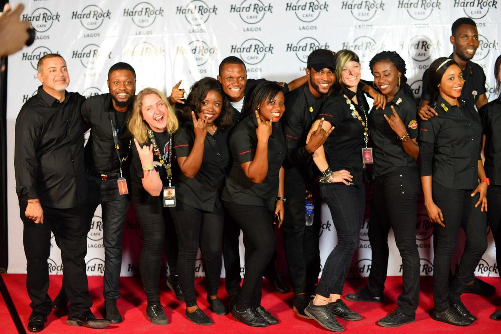 Hard Rock Cafe Lagos Launch BellaNaija Sanjay Mahtani, Co-Founder & Executive Director SJM Ventures LTD with staff of Hard Rock Café Lagos