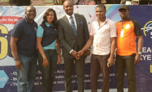 "L-R: Business Development Manager, Eziukwu Road Branch , Aba, Chinedu Oguejiofor, Head, Retail Banking ,Nkolika Okoli, Regional Director , South East 2, Chukwudi Onuegbu, Winner, N250,000 at Ariaria Market today, A businessman, Chinonso Ezeanya and Assistant Manager, National Lottery Regulatory Commission, Opara Celestine at the Bank's ""Reach For The Skye"" reward draw held in Ariaria International Market, Aba in Abia State on 21st January , 2016"