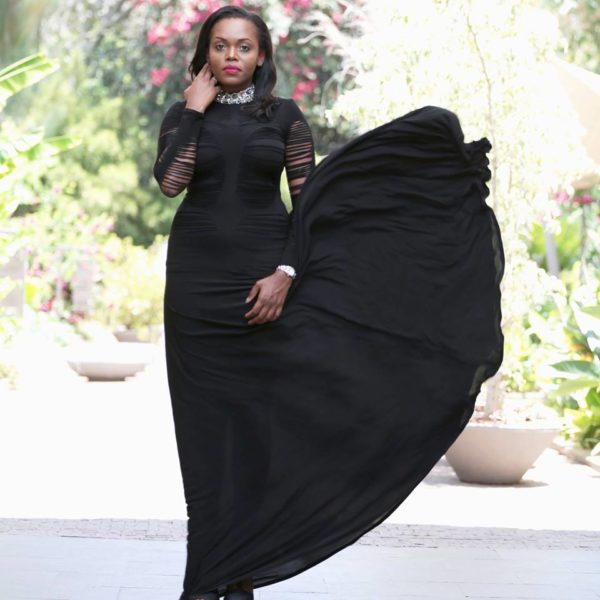 Diana Opoti wearing a stunning slashed black number by Zimbabwe's David Alford
