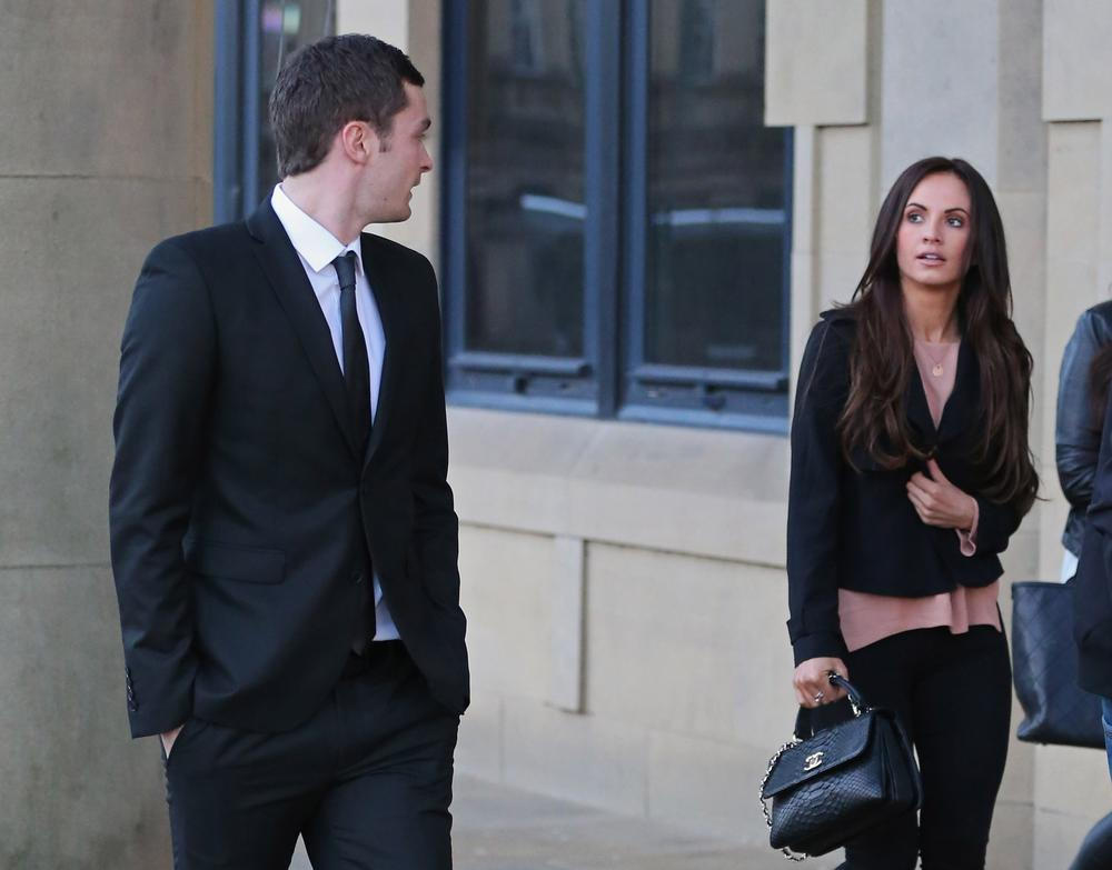 BRADFORD, ENGLAND - FEBRUARY 10: Adam Johnson with girlfriend Stacey Flounders leaving Crown Court after admitting two charges against him and pleading not guilty to two others on February 10, 2016 in Bradford, England. The Sunderland FC midfielder, aged 28 and from Castle Eden, County Durham, will go on trial for two counts of sexual activity having pleaded guilty to two others. He has one daughter. (Photo by Nigel Roddis/Getty Images)