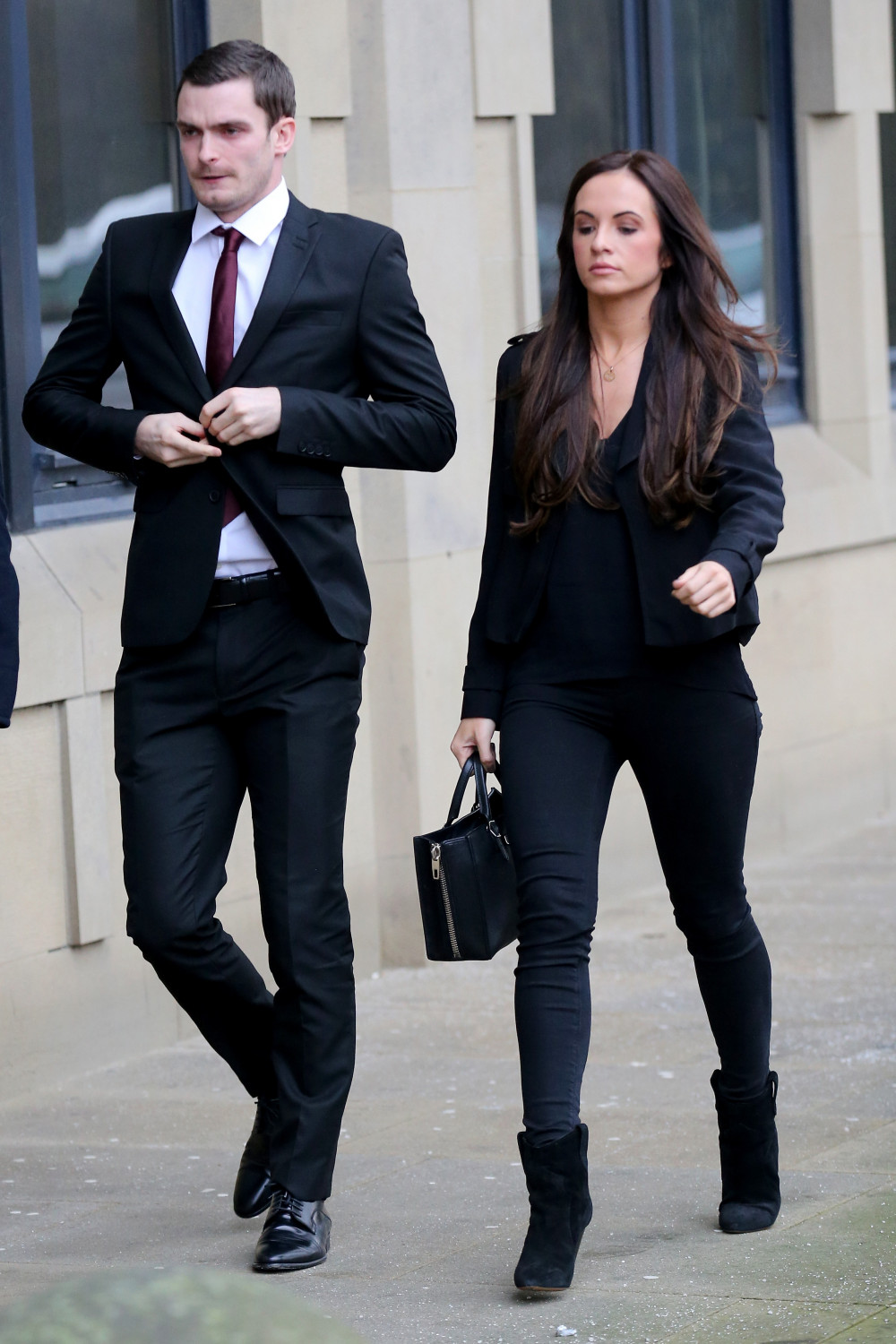 Adam Johnson and his girlfriend Stacey Flounders arrive at Bradford Crown Court where Johnson is facing child sexul assault charges on February 12, 2016 in Bradford, England. The fomer Sunderland FC midfielder, aged 28 and from Castle Eden, County Durham, is on trial for two counts of sexual activity having pleaded guilty to two others.