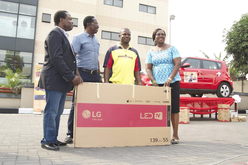 "2nd Prize winner of a 55"" LED TV, Ikechukwu Onukoga, receiving his prize"