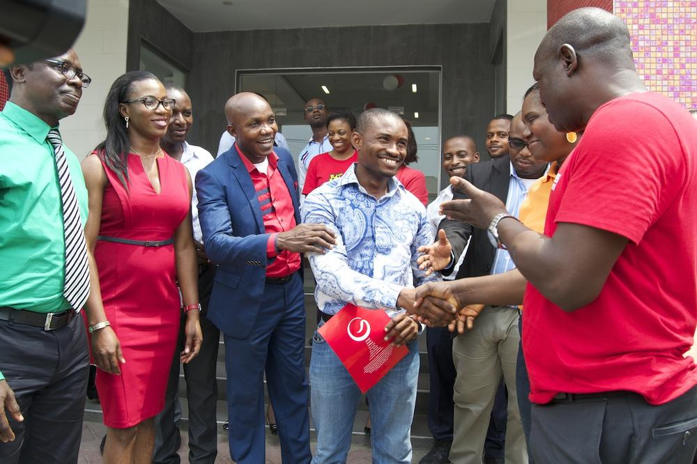3rd Prize Winner, Chidi Dike, of an All-Expense Paid trip to Genesis Sojouner Hotel Lagos being congratulated