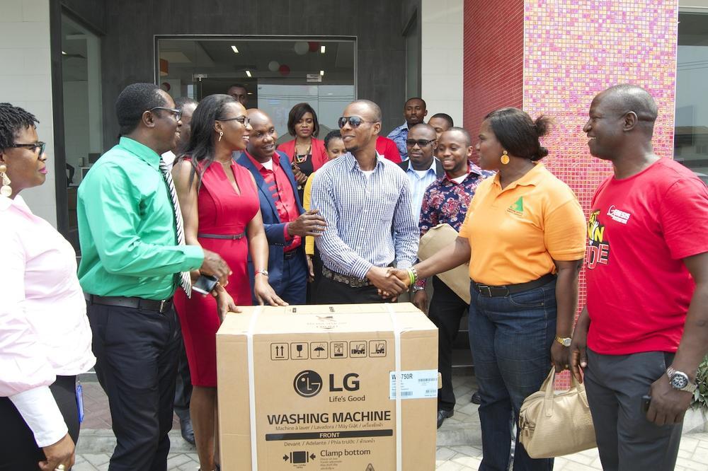 4th Prize winner of an LG washing machine, Okechukwu Jerimiah, receiving his prize