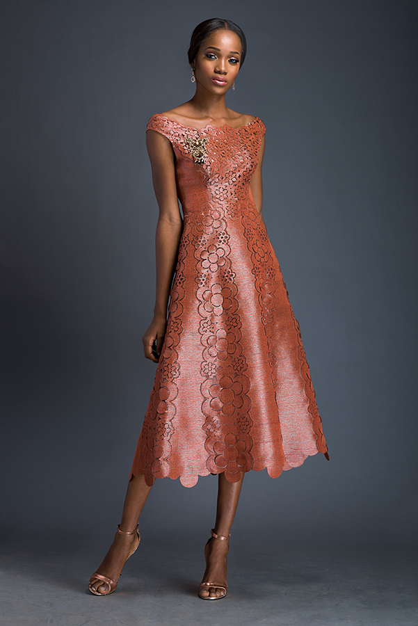 Eleanor - Coral A-line dress with soft shoulder straps. Dress is patterned with Komole Kandids Daisy motif.