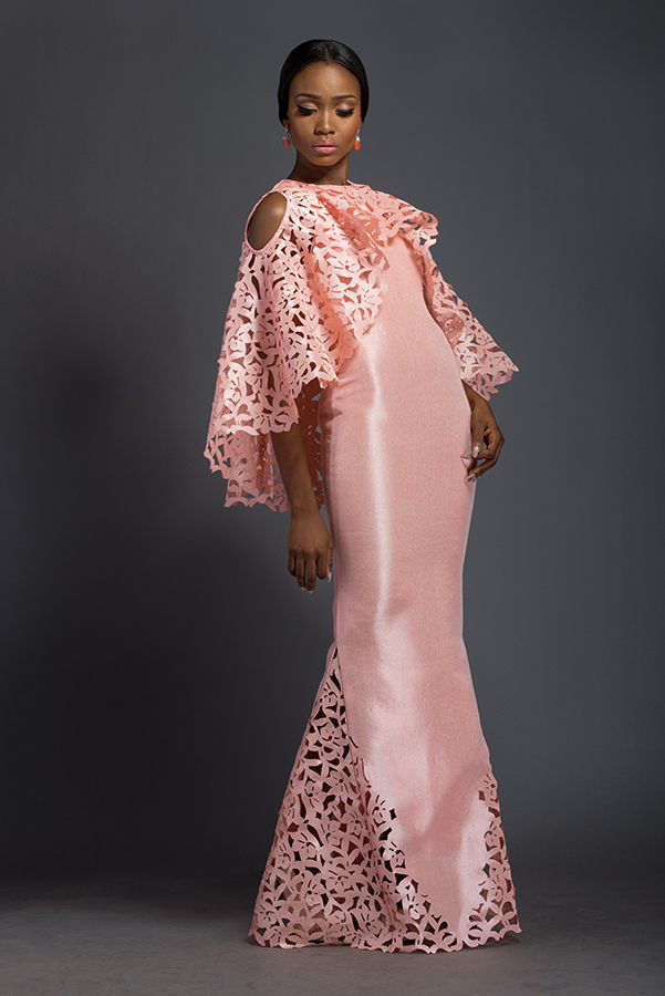 Elizabeth - Cherry blossom pink floor length dress with fringe fascia cape. Fringe fascia cape is patterned with Komole Kandids Azalea motif, and skirt is panelled with Komole Kandids Azalea motif.