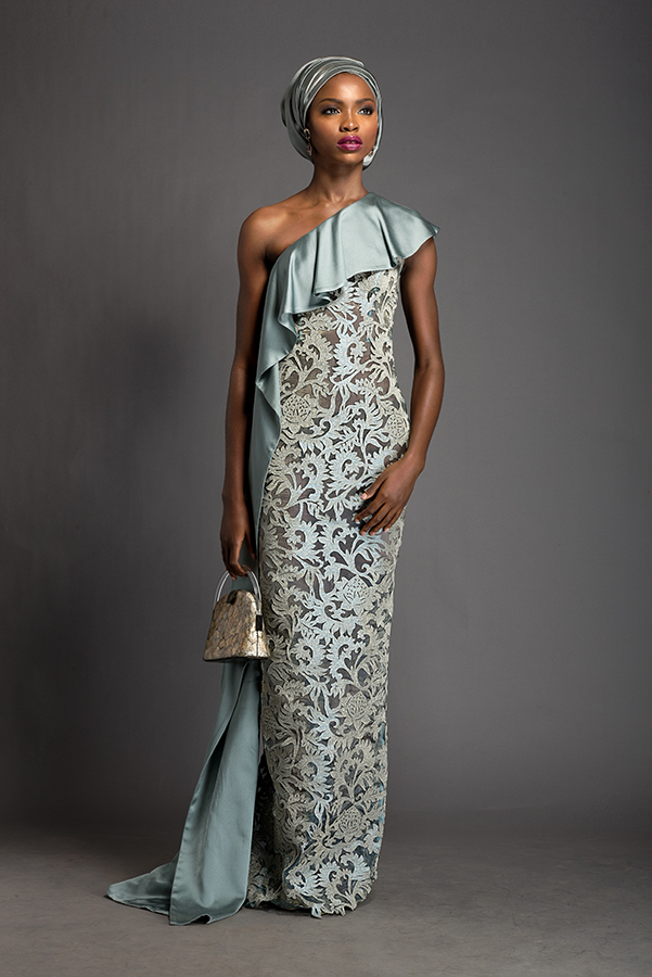 Imani - One shoulder celadon floor length dress with attached ruched 'ipele'. Dress patterned with Komole Kandids Forest motif.