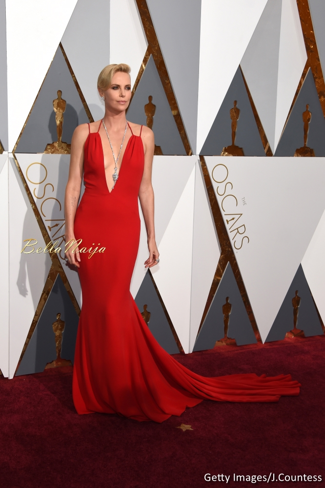 Charlize Theron wearing a Dior Haute Couture dress and $3.7 million worth of Harry Winston diamonds