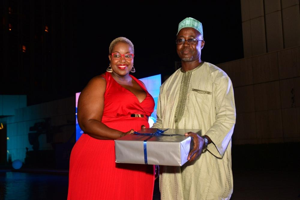 Lusanda Jiya, SAA GM Stakeholder Relations presents gift to Mr Hassan Musa, the Director of Air Transport, Ministry of Transportation