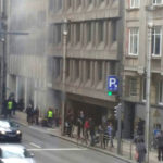 A picture taken on March 22, 2016 shows smoke rising from the Maalbeek underground, in Brussels, following a blast at the station close to the capital's European quarter.  The Brussels metro service was being shut down on March 22, its operator said. The measure came after a rush-hour explosion at Maalbeek station with TV images showing black smoke pouring from the station entrance.  / AFP / Belga / Seppe KNAPEN / Belgium OUT        (Photo credit should read SEPPE KNAPEN/AFP/Getty Images)