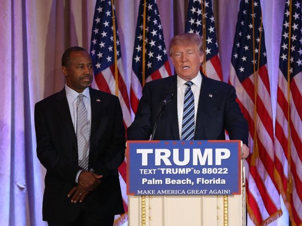 PALM BEACH, FL - MARCH 11:  Republican presidential candidate Donald Trump stands with former presidential candidate Ben Carson as he receives his endorsement at the Mar-A-Lago Club on March 11, 2016 in Palm Beach, Florida. Presidential candidates continue to campaign before Florida's March 15th primary day.  (Photo by Joe Raedle/Getty Images)