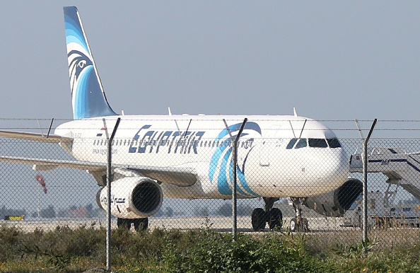 An EgyptAir Airbus A-320 sits on the tarmac of Larnaca airport after it was hijacked and diverted to Cyprus on March 29, 2016.  / AFP / STR        (Photo credit should read STR/AFP/Getty Images)