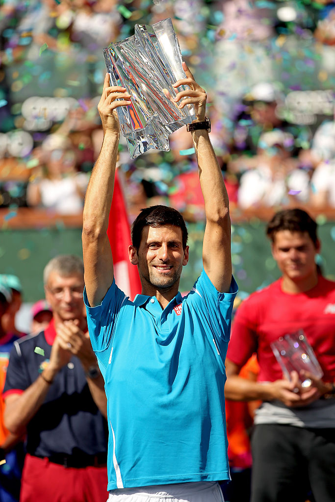 INDIAN WELLS, CA - MARCH 20: Novak Djokovic of Serbia celebrates with the winner's trophy after defeating Milos Raonic of Canada during the mens final of the BNP Paribas Open at the Indian Wells Tennis Garden on March 20, 2016 in Indian Wells, California. (Photo by Matthew Stockman/Getty Images)