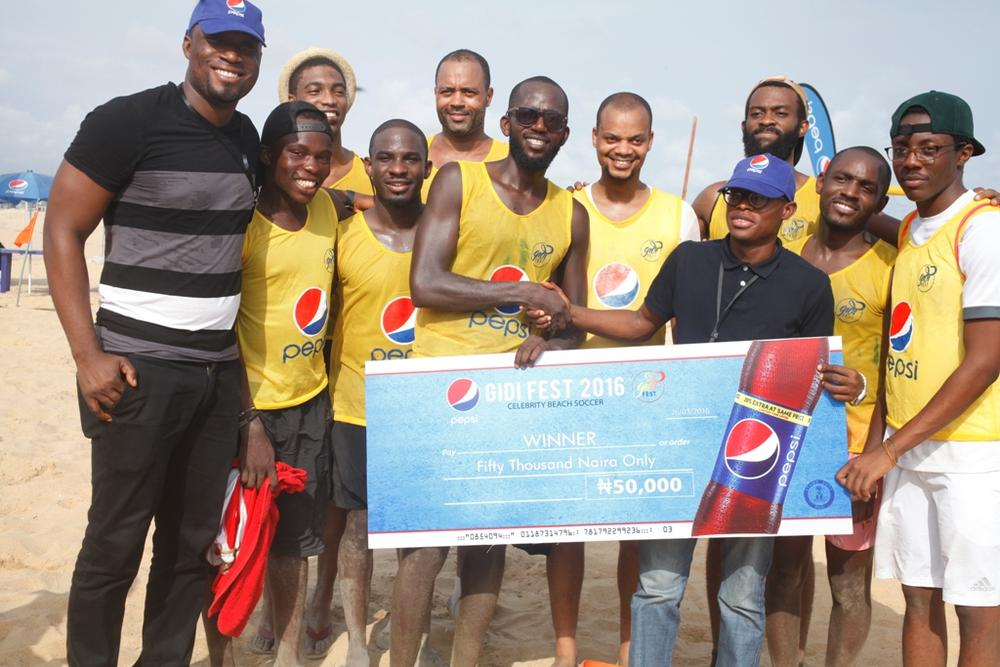 Marketing Manager, SBC, James Adah and the Brand Manager, SBC, Segun Ogunleye rewarding winners of the beach soccer game at Gidi Fest