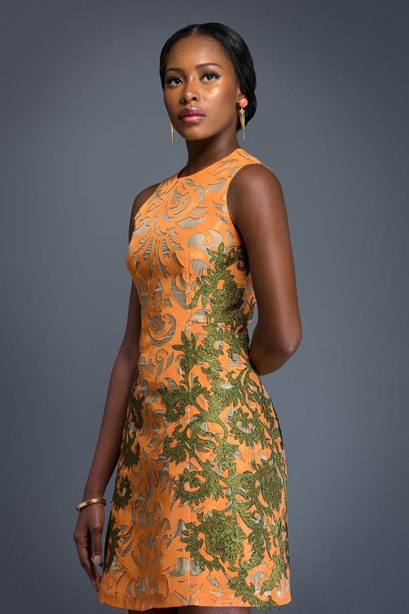 MALIA Dark tangerine Aso-oke dress, patterned with olive Komole Kandids Forest on Nectar motif.