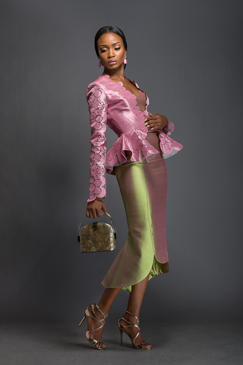 BELLA X ROSA Pastel violet Aso-oke peplum jacket patterned with Komole Kandids Daisy motif. Apple green midi skirt with winged hem.