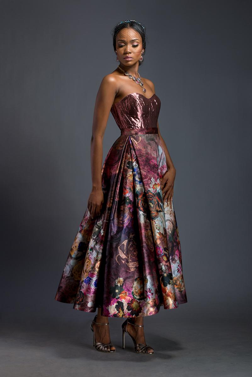 FARI X YASMIN Dark raspberry liquid metal corset. Floral A-line skirt.