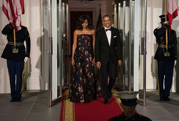 US President Barack Obama and First Lady Michelle Obama walk out to ...