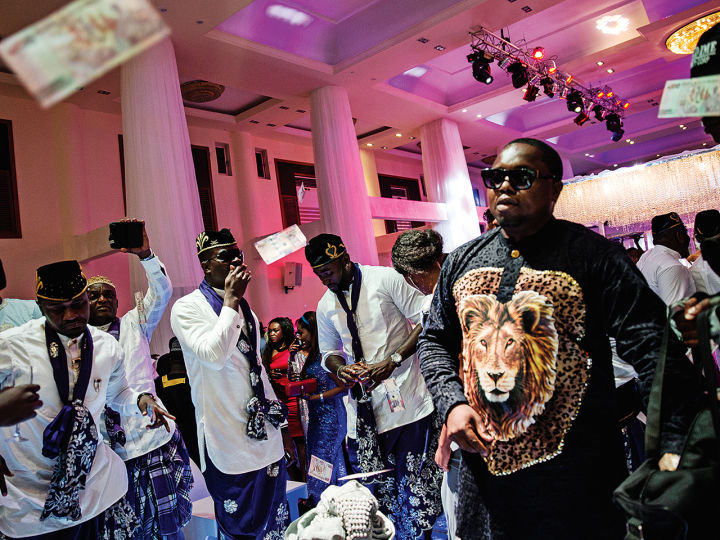 """Ubi Franklin's Wedding - Playboy Caption: """"A posh wedding in Lekki filled with guests from the music and film industries and complete with """"spraying""""— throwing money in the air in the bride and groom's direction."""" 
