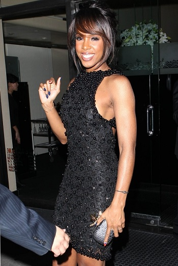Kelly Rowland in an embellished mini Gert-Johan Coetzee dress