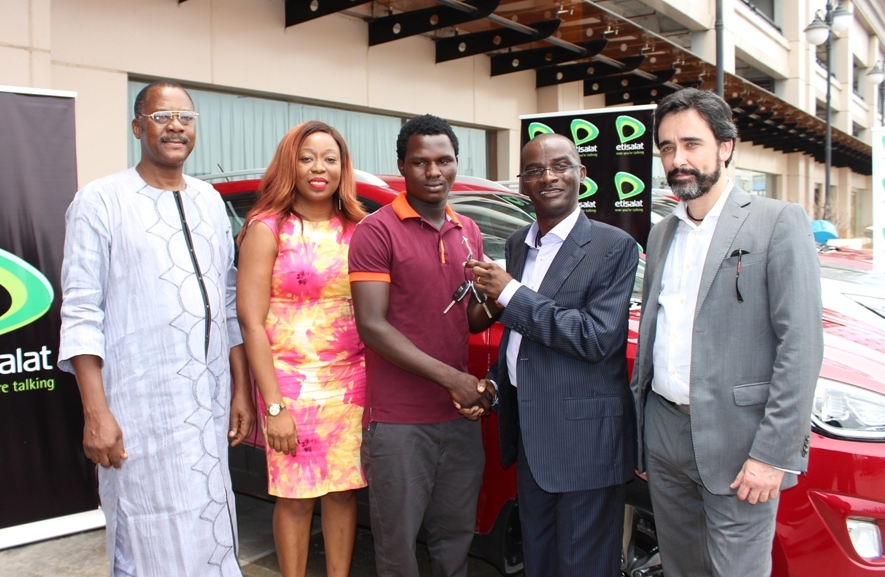 Head, Consumers Protection Council (CPC), Lagos, Joshua Nggada; Director, Digital Business, Etisalat Nigeria, Adia Sowho; Winner of Star Prize, Amos Noel; Chief Product and Information Officer, Etisalat Nigeria; Otuyemi Otule; and MD/CEO, TimWe; Bruno Cardozo during the presentation of Car prizes to winners of Etisalat's Win Big Promo