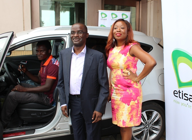 One of the Star Prize Winner, Amos Noel in his car, Chief Product and Information Officer, Otuyemi Otule and Director, Digital Business, Adia Sowho Etisalat Nigeria both of Etisalat Nigeria during the presentation of Car prizes to winners of Etisalat's Win Big Promo