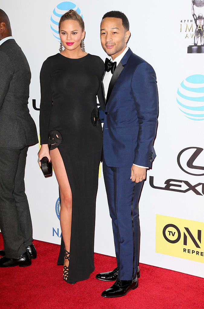PASADENA, CA - FEBRUARY 05: Model Chrissy Teigen, left, and recording artist John Legend attend the 47th NAACP Image Awards presented by TV One at Pasadena Civic Auditorium on February 5, 2016 in Pasadena, California. (Photo by David Livingston/Getty Images)