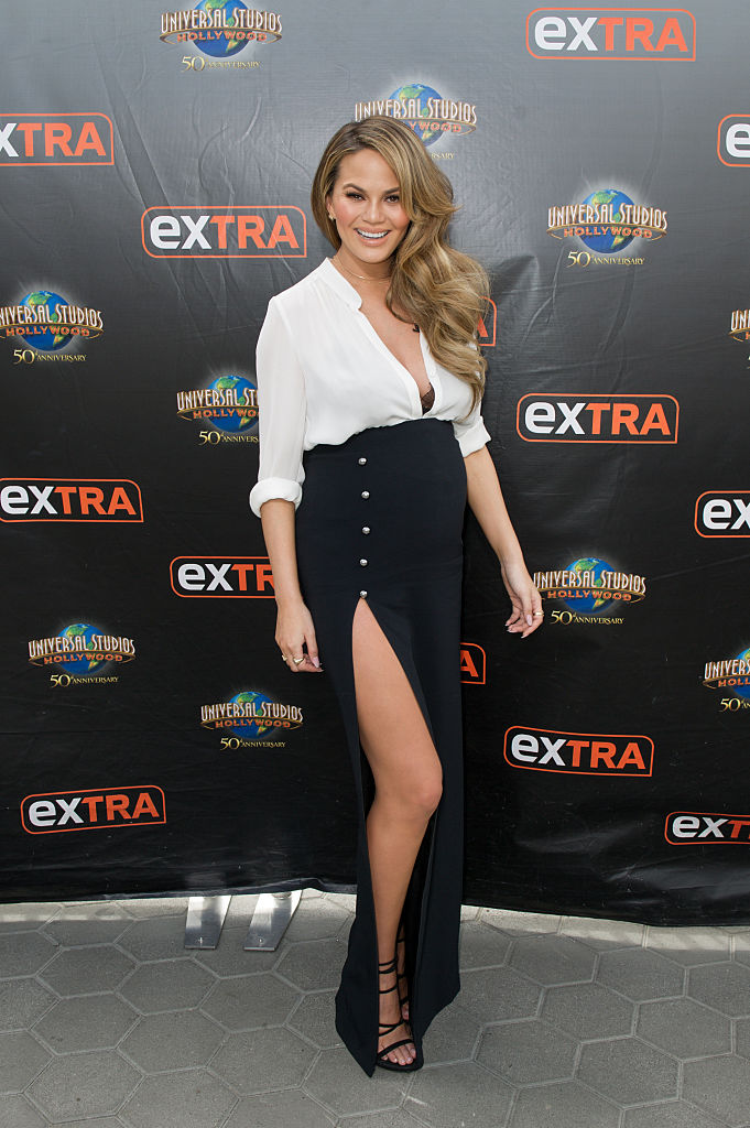 "UNIVERSAL CITY, CA - MARCH 11: Chrissy Teigen visits ""Extra"" at Universal Studios Hollywood on March 11, 2016 in Universal City, California. (Photo by Noel Vasquez/Getty Images)"