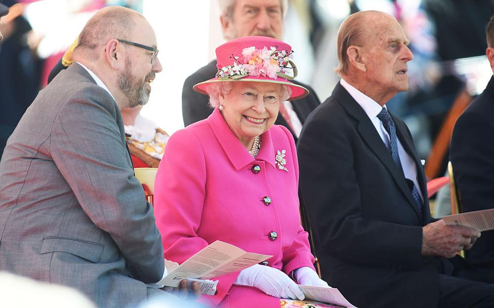 WINDSOR, ENGLAND - APRIL 20: Queen Elizabeth II and Prince Phillip, Duke Of Edinburgh watch a performance of local acts to open the Alexandra Gardens Bandstand as part of her 90th Birthday celebrations In Windsor on April 20, 2016 in Windsor, England. (Photo by Stuart C. Wilson/Getty Images)