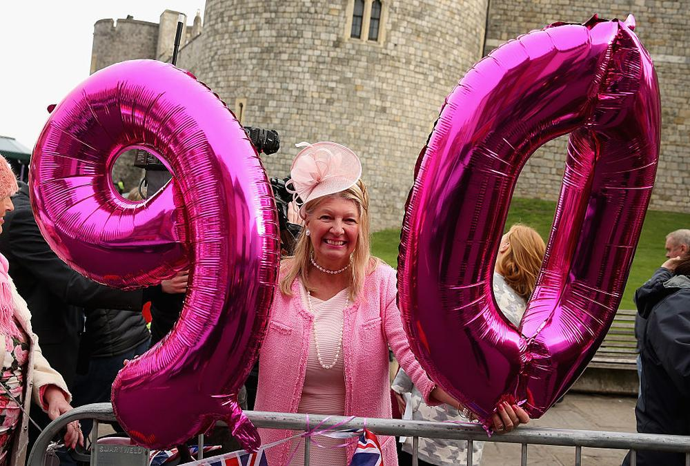 WINDSOR, ENGLAND - APRIL 21: Judy Daley from Cardiff waits in position for the Queen's 90th Birthday Walkabout on April 21, 2016 in Windsor, England. Today is Queen Elizabeth II's 90th Birthday. The Queen and Duke of Edinburgh will be carrying out engagements in Windsor. (Photo by Chris Jackson/Getty Images)