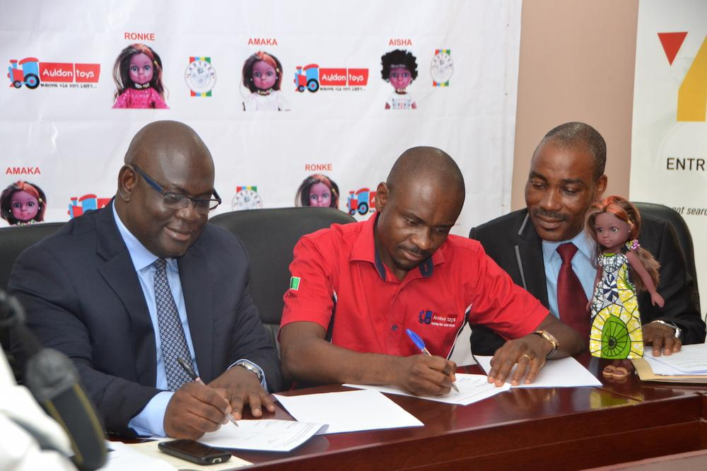 Olawumi Gasper, executive secretary, Lagos State Technical and Vocational Education Board (LASTVEB); Paul Orajiaka, CEO, Auldon Toys, and Awoyera Oluremi, director, modern apprenticeship training program, LASTVEB, at the signing of MoU between LASTVEB and Auldon Toys for the clothing of the Unity Dolls in Lagos.