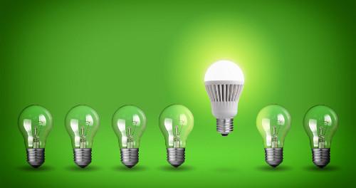 Row of light bulbs.Idea concept on green background.