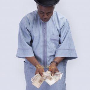 Man Holding Money - Naira | Nsoedo Frank | Foto.com.ng