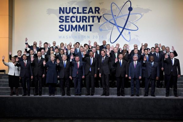 U.S. President Barack Obama, center, waves among other heads of state and attendees during a family photo at the Nuclear Security Summit in Washington, D.C., U.S., on Friday, April 1, 2016. After a spate of terrorist attacks from Europe to Africa, Obama is rallying international support during the summit for an effort to keep Islamic State and similar groups from obtaining nuclear material and other weapons of mass destruction. Photographer: Andrew Harrer/Bloomberg via Getty Images