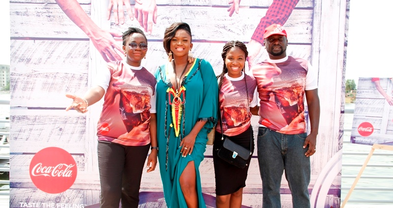 Waje with members of the Coca-Cola Team