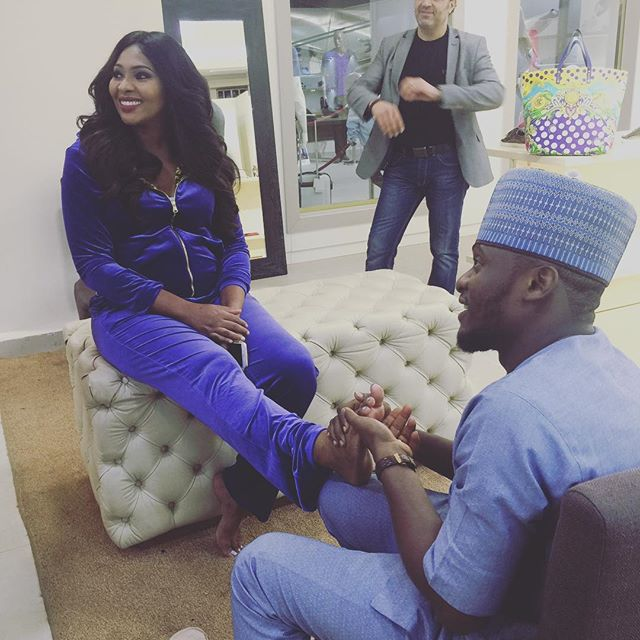 Ubi Franklin working on his wife Lilian Esoro
