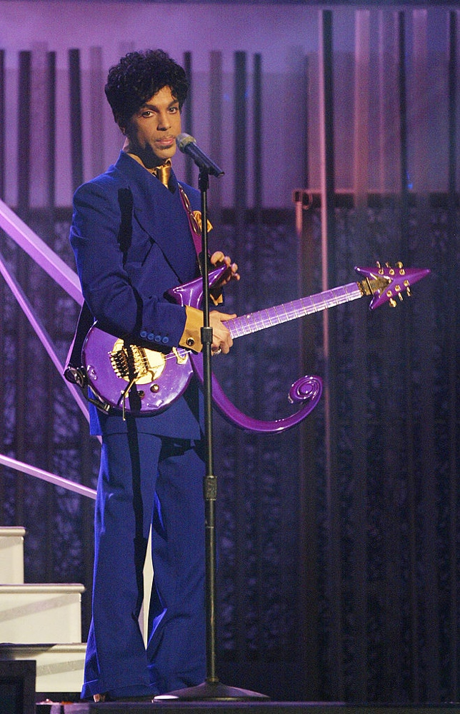 "LOS ANGELES - FEBRUARY 8: Grammy and Oscar-winning recording artist Prince performs the song ""Purple Rain"" at the 46th Annual Grammy Awards held at the Staples Center on February 8, 2004 in Los Angeles, California. (Photo by Frank Micelotta/Getty Images)"