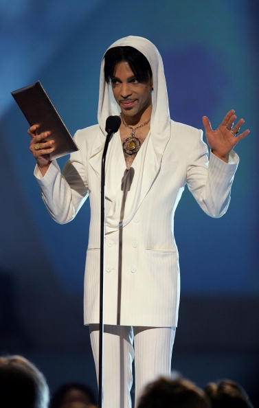 "PASADENA, CA - JANUARY 9: Musician Prince presents the award for ""Favorite Leading Lady"" onstage during the 31st Annual People's Choice Awards at the Pasadena Civic Auditorium on January 9, 2005 in Pasadena, California. (Photo by Frank Micelotta/Getty Images)"