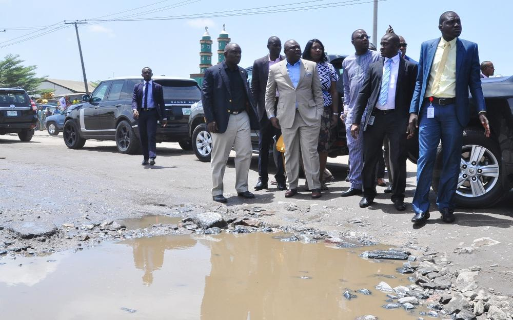 Lagos State Governor, Akinwunmi Ambode (2nd left), with his Special Adviser on Lagos Global, Prof. Ademola Abass (3rd left) and Managing Director, Lagos State Waterways Authority (LASWA), Engr. Abisola Kamson (middle) during his inspection of the bad portion of Berlett Bus Stop on Apapa- Oshodi Expressway, Lagos, on Friday, May 13, 2016