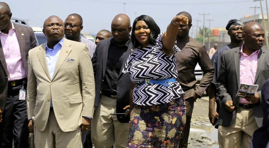 L-R: Lagos State Governor, Akinwunmi Ambode; Managing Director, Lagos State Waterways Authority (LASWA), Engr. Abisola Kamson and Commissioner for Waterfront Infrastructure Development, Engr. Adebowale Akinsanya during the Governor's inspection of the bad portion of Berlett Bus Stop on Apapa- Oshodi Expressway, Lagos, on Friday, May 13, 2016.