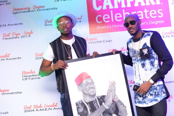 Artist, Folabi David and 2Baba during the 2Baba painting presentation
