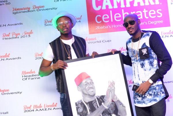 Artist, Folabi David and 2Baba during the 2Baba painting presentation