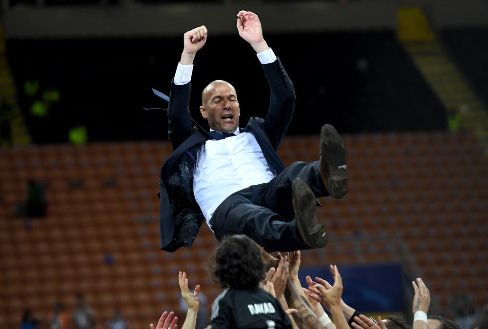 MILAN, ITALY - MAY 28: Real Madrid head Zinedine Zidane is thrown in the air after the UEFA Champions League Final match between Real Madrid and Club Atletico de Madrid at Stadio Giuseppe Meazza on May 28, 2016 in Milan, Italy. (Photo by Matthias Hangst/Getty Images)