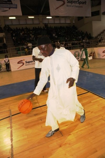 Minister of Sports, Barrister Solomon Dalong bouncing the ball