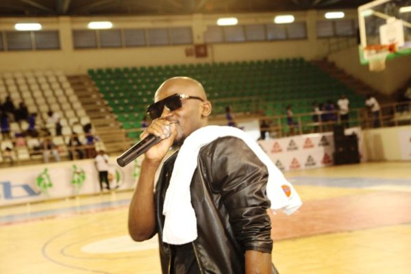 Kennis Music artiste, JoEL Amadi serenades the audience at the DStv Premier Basketball league All Star game in Abuja.