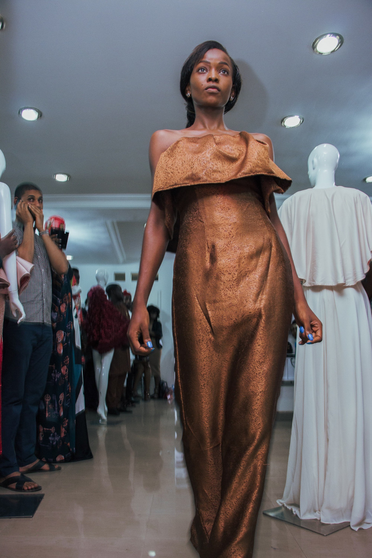 A model strutting in a Maison Mimi AW16 piece