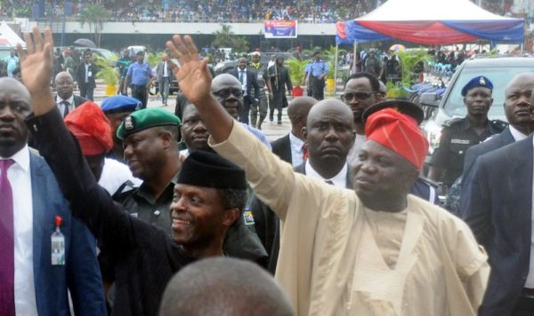 PIC. 12. VICE PRESIDENT YEMI OSINBAJO (L) AND GOV. AKINWUNMI AMBODE OF LAGOS STATE ACKNOWLEDGING CHEERS FROM THE CROWD ON ARRIVAL AT TAFAWA BALEWA SQUARE VENUE FOR THE INAUGURATION OF SOME SECURITY EQUIPMENT, DURING THE WORKING VISIT OF THE VICE PRESIDENT TO LAGOS STATE AS REPRESENTATIVE OF PRESIDENT MUHAMMADU BUHARI ON MONDAY (23/7/16). 3750/23/5/2016/BOA/MA/NAN
