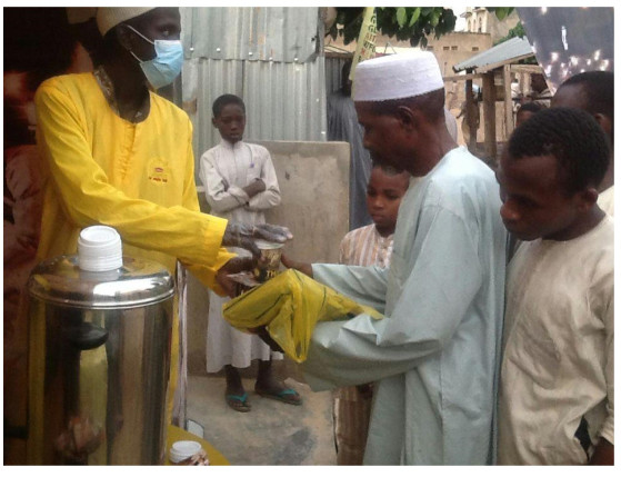 A muslim faithful being handed his refreshment at the lipton ramadan lounge in Bauchi State
