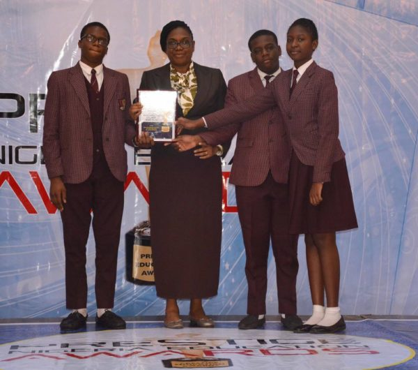 Caleb International College representative after winning Best Secondary School in Lagos (Private) Award